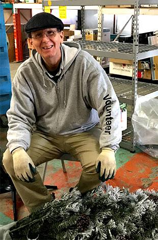 Ken Lapp volunteering at Habitat For Humanity